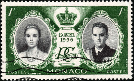 grace:  CIRCA 1956  A stamp printed in Monaco showing prince Ranier of Monaco and princess Grace Kelly, circa 1956 Stock Photo