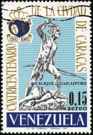centenarian:  CIRCA 1967  A stamp printed in Venezuela showing cacique guaicaipuro statue for the four hundred year old of caracas city, circa 1967 Stock Photo