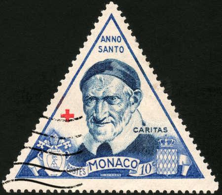 philatelic:  CIRCA 1950  A stamp printed in Monaco showing Anno Santo caritas, circa 1950 Stock Photo