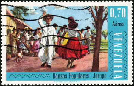 CIRCA 1966  A stamp printed in Venezuela showing traditional venezuelan dance, circa 1966 Stock Photo