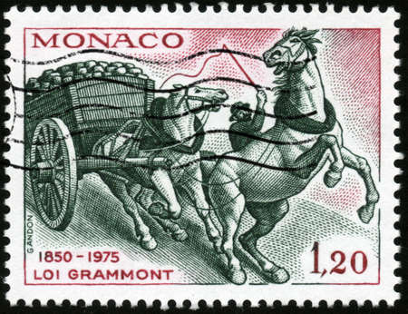 philatelic: CIRCA 1975  A stamp printed in Monaco showing horses pulling a cart for the law Grammont for protection of animals, circa 1975