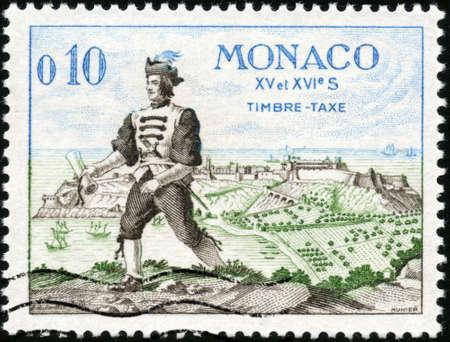 xvi: CIRCA 1960  A stamp printed in Monaco showing A man of the XV and XVI century, circa 1960