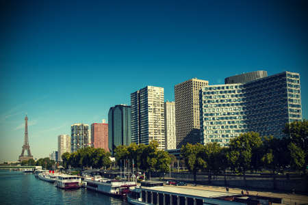 Modern skyscrapers in the urban area of Paris with the Tour Tiffel photo