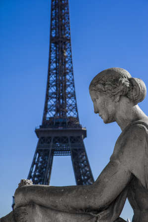 Statue of woman at the Trocadero with Tour Eiffel photo