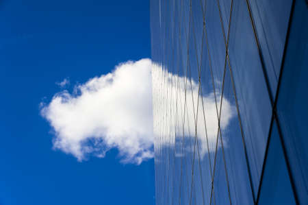 Skyscraper with cloud reflected on it