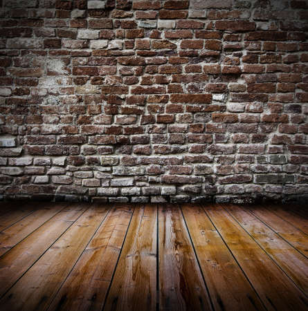 Grunge old interior with brick wall and wooden floor photo