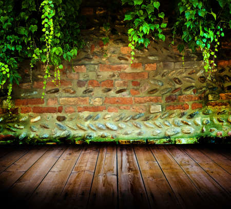 Grunge old wall with wooden planks floor photo