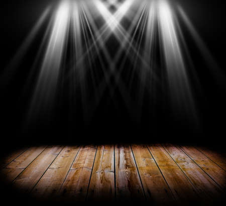 vocals: Two spot light on a wooden floor and a black background Stock Photo