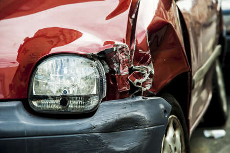 broken car: Details of a red car in an accident