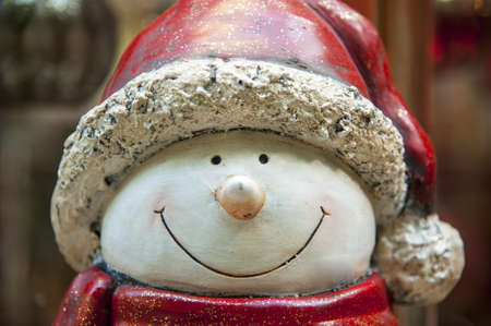 Face of a cute snowman statue isolated on background photo