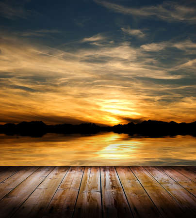 Beauty sunset over a wooden floor and the sea photo