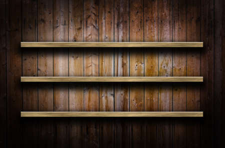 Old grunge wood panels used as background with shelves photo