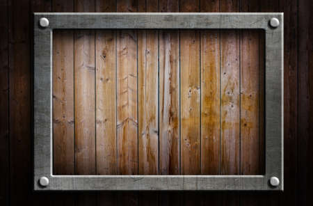 western border: A metal frame on a wooden background Stock Photo