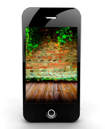 A smartphone isolated on a white background with brick wall and ivy photo
