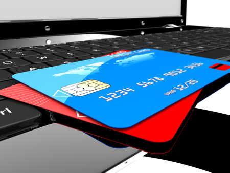 technology transaction: Two credit cards on a laptop  Online payments concept Stock Photo