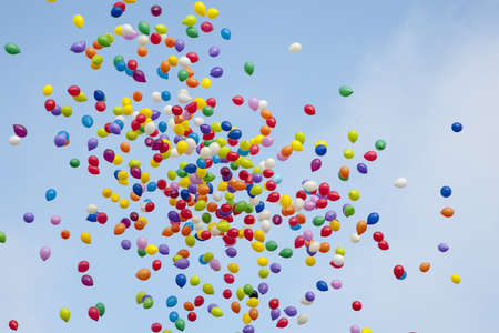 Many colorful balloons flying in the air