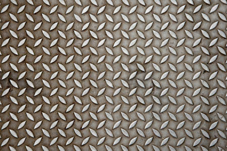 Background of metal diamond plate in silver color photo