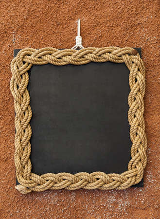 Rope frame on a blackboard used lika a copyspace photo