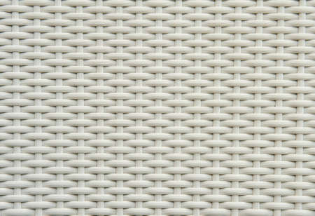 rattan mat: A chair white white basket weave pattern