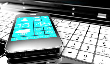 A smartphone on a keyboard of a laptop Stock Photo - 21352643