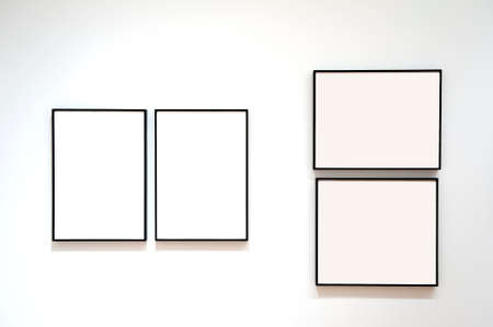 Four blank frames on a white wall photo