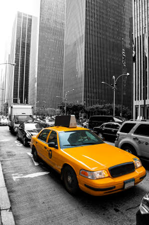 Yellow taxi in the black and white New York photo