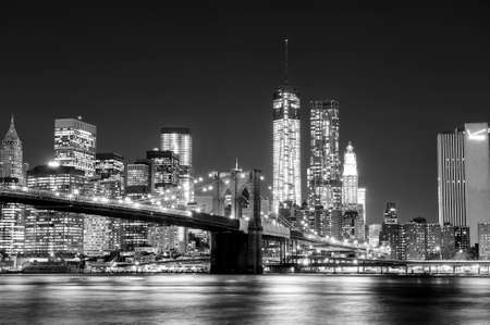 The Manhattan skyline and Brooklyn Bridge at night seen from Brooklyn Bridge Park in Brooklyn, New York.
