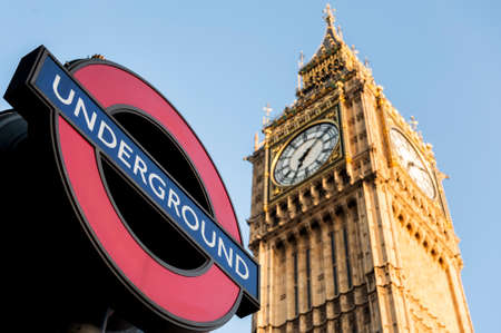 Close up of Big Ben Clock Tower and Underground Sign Against Blue Sky