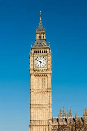 Close up of Big Ben Clock Tower Against Blue Sky England United Kingdom photo