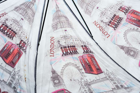 An open umbrella with British illustrations on it
