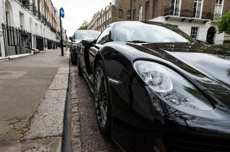 designates: Luxury car parked in old European city street