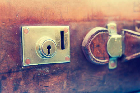 bygone: Close up on the lock of a vintage suitcase Stock Photo