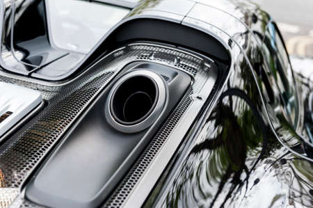 Close up on pipe of a luxury black car