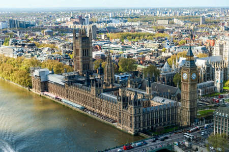 britain: View of House of Parliament with Thames river in London Editorial