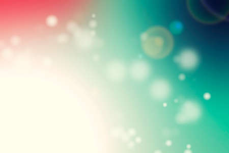 natures: Soft colored abstract background with bokeh effect and lens flare