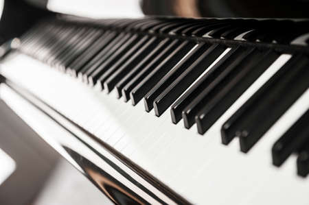 keyboard: Piano keyboard background with selective focus. Lateral view