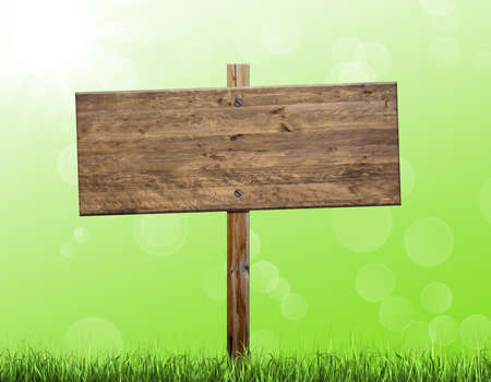 outdoor advertising construction: Wooden billboard isolated on a green background