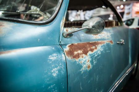 Close up of a vintage blue car with rust Stock Photo