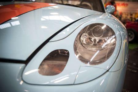internships: Front of a blue sport car illuminated in a salon