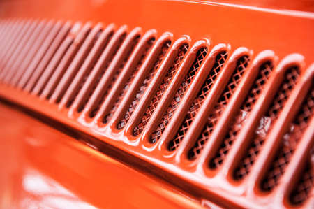 car grill: Abstract cooling grill detail of a red vintage car