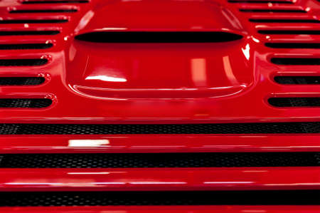metal parts: Abstract cooling grill detail of a red modern sport car