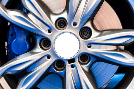 car part: Close up of a modern sport wheel with blue brake