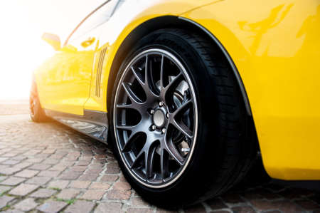 Back of a yellow modern sport car in sunset Stock Photo