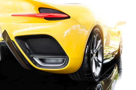 Back of a yellow modern sport car in sunset 스톡 콘텐츠