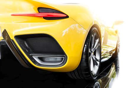 Back of a yellow modern sport car in sunset Foto de archivo