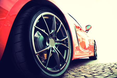 Back of a red modern sport car in sunset Archivio Fotografico
