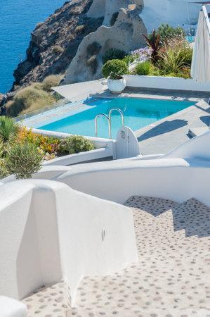 Beautiful pool over the sea in Santorini island - Greece