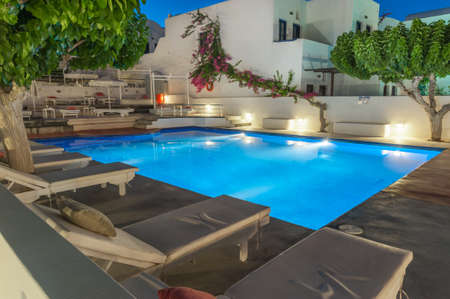 tropical garden: Beautiful pool in Santorini by night - Greece