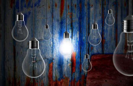 Light bulbs on a blue grunge background Stock Photo