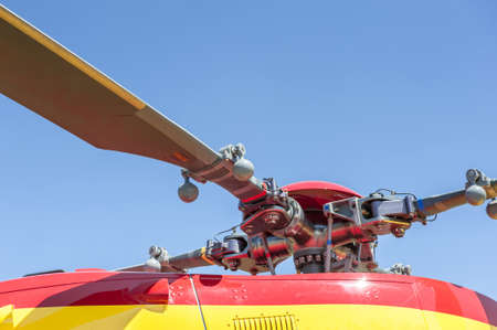 Close up of a red and yellow helicopter